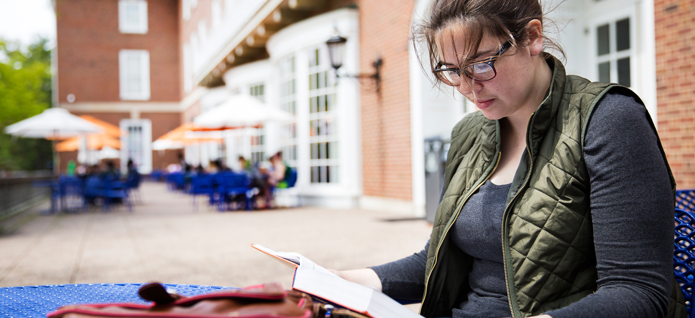 A student studies for finals outside the Illini Union.